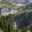 Mountain with the glacier cap and huge waterfall, Klausenpass — Stock Photo