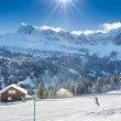 Child learning skiing in Swiss Alps - Klewenalp ski resort during a beautiful sunny day, Central Switzerland — Stock Photo #41577105