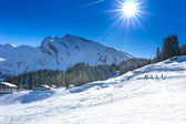 People skiing and sledging in Klewenalp ski resort in Swiss Alps — Stock Photo