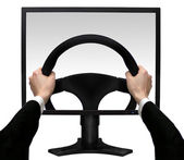 Hands on a steering wheel in the screen the monitor isolated white background — Foto Stock