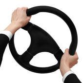 Mains sur un volant de direction, tourner à gauche isolée sur fond blanc — Photo