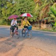 Stock Photo: Boy and girl riding bicycle. Laos.