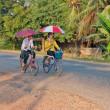 Boy and girl riding bicycle. Laos. — Stock Photo