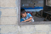 Little boy in the window. Vang Vieng. Laos. — Stock Photo