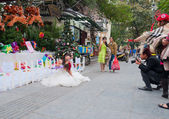 Photosession of the brides in a white dress on the street. Hano — Stock Photo