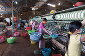 Vietnamese women working in silk factory. Dalat. Vietnam — Stock Photo
