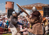 Medieval fight at a historical reenactment festival held in Abal — Stock Photo