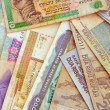 Stock Photo: Background of different currencies