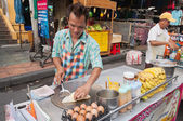 Man cooks Thai Banana Pancake on the street — Stock Photo