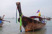 Traditional longtail boats on the Ao Nang beach at morning — Stock Photo