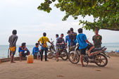 Unidentified local people on the beach at morning — Stock Photo