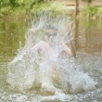 Boy splash water in the river — Stock Photo #51626215