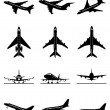 Different passenger aircrafts in flight — Stock Vector