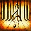 Abstract piano background and Treble clef. — Stock Photo #23986551
