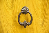 Knocker on wooden door. — Stock Photo