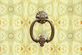 Old style knocker on wallpaper — Стоковое фото