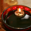 Candle lit oil — Stock Photo