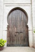 Wooden door in an oriental style. — Stock Photo