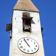 Ancient bell tower with clock — Stock Photo