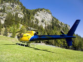 Helicopter on the lawn in peyo Valley, Italy — Stock Photo