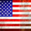 Flag of the United States and the statue of liberty on grunge background. — Stock Photo