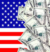 Dollars and American flag — Stock Photo