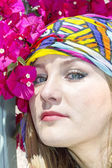 Girl with headpiece and colorful bougainvillea flowers — Stock Photo
