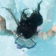Girl immersed in the pool — Stock Photo
