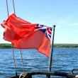 Canadian flag on Penetanguishene Bay, Ontario , Canada. — Stock Photo