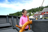 Girl riding the ancient ship in Discovery Harbour in Penetanguishene, Canada. — Stock Photo
