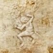 Grunge background and bas-relief with men dancing — Stock Photo #34569067