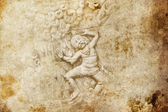 Grunge background and bas-relief with men dancing — Stock Photo