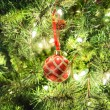 Red ball in the Christmas tree. — Stock Photo