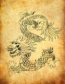 Ancient Chinese Dragon on grunge background — Stock fotografie