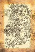 Dragon on grunge background — Stockfoto