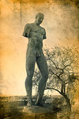 Igor Mitoraj sculpture and Agrigento Temple, Italy on grunge background — Stok fotoğraf