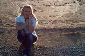 Sad girl on the beach — Stock Photo