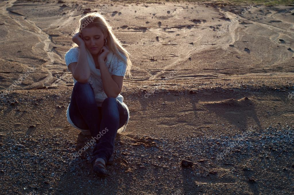 Sad girl on the beach ...