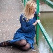 Young girl  on a bridge — Stock fotografie