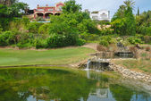 Pond in golf course — Stok fotoğraf
