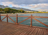 A pier in Marbella beach — Stock Photo