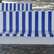 Blue and white benches — Stock Photo