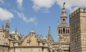 Cathedral, Giralda and Alcazar wall. — Stock Photo