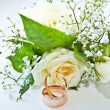 Bridal Bouquet and wedding rings - Stockfoto
