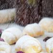 Sugar dusting sweet pastry — Stock Photo