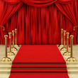 Gold stanchions and a red carpet - ストック写真
