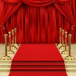 Gold stanchions and a red carpet - Stock Photo