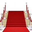 Silver stanchions and a red carpet — Stock Photo
