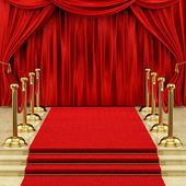 золото стоек и красный ковер — Стоковое фото