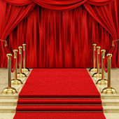 Gold stanchions and a red carpet — 图库照片